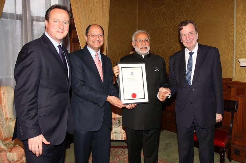 British Justice Secretary Shailesh Vora presenting the documents to Modi