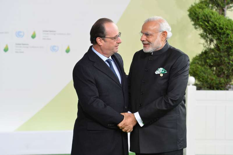 Modi being received by the President of France, Mr. Francois Hollande, on his arrival for the UNFCCC Climate Conference, in Paris (File)