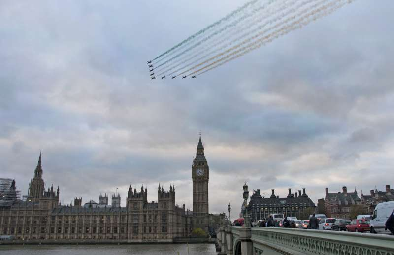 The Red Arrows celebrate the arrival of Prime Minister Narendra Modi with a flypast over Parliament Square, London. They created the Tricolour with their fumes