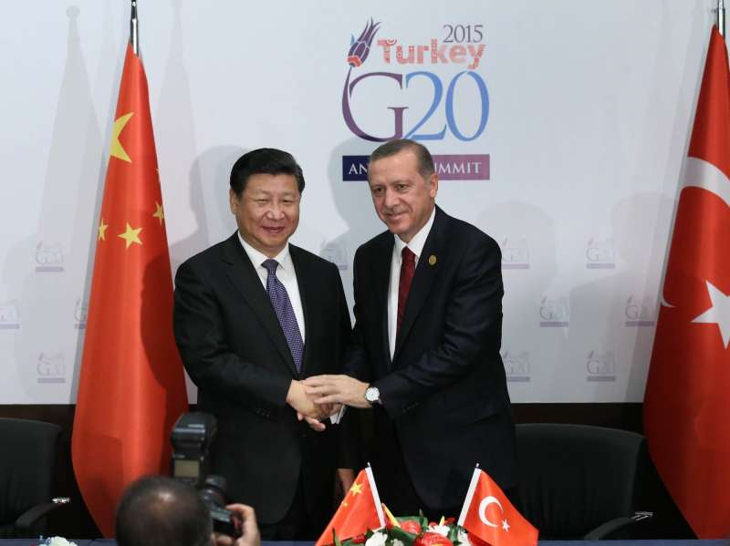 Chinese President Xi Jinping (L) shakes hands with his Turkish counterpart Recep Tayyip Erdogan in Antalya, Turkey