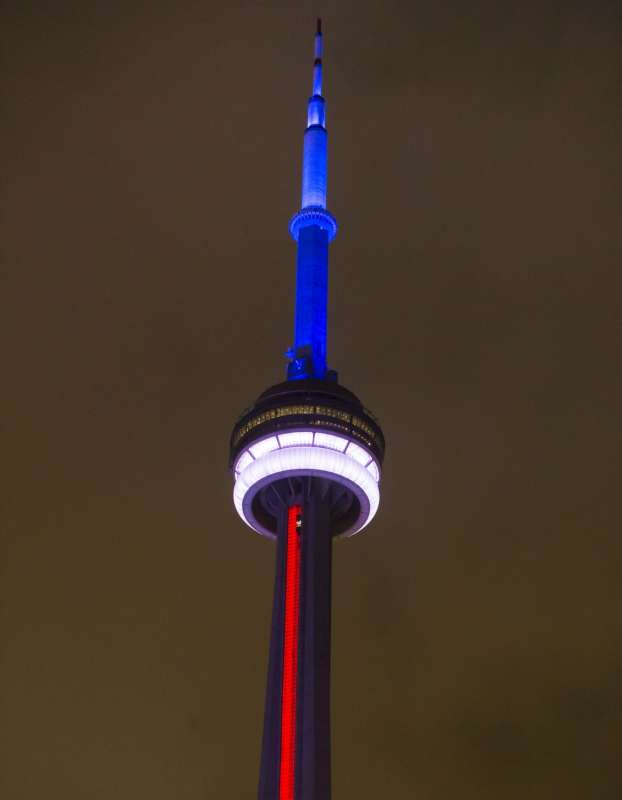 Colors that resemble the French national flag are seen on the Canadian National Tower in Toronto