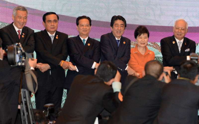Leaders shake hands during the 18th Association of Southeast Asian Nations (ASEAN)-China, Japan and South Korea (10+3) leaders' meeting in Kuala Lumpur, Malaysia