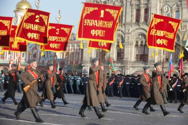 A military squad holding red standards bearing names of front lines marches on the Red Square in Moscow, Russia. The parade marks the 74th anniversary of historical parade in 1941 when Soviet soldiers marched through the Red Square towards the front lines during the World War Two