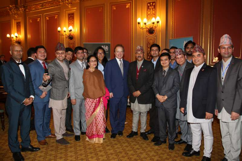 Foreign Office Minister Hugo Swire and Kamal Thapa, Deputy Prime Minister and Minister for Foreign Affairs of Nepal with Chevening scholars