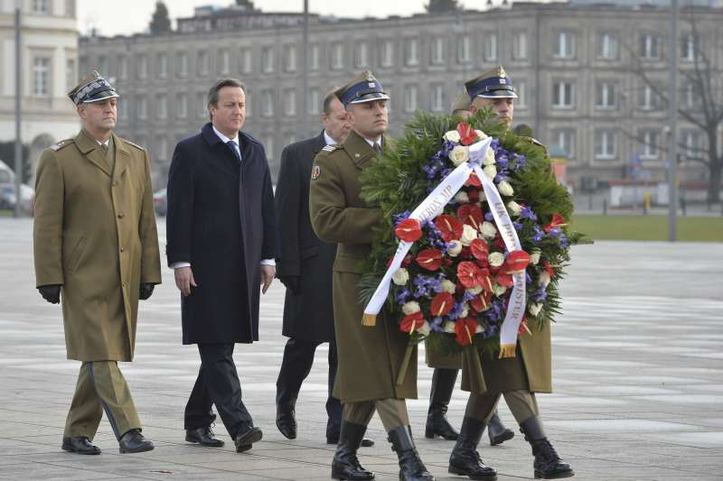 Prime Minister David Cameron paying tributes to the unknown soldier's memorial at Warsaw in Poland (File)