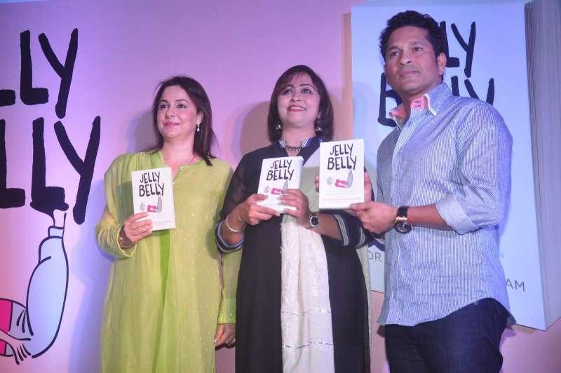Author Dr Aparna Santhanam with former cricketer Sachin Tendulkar and Anjali Tendulkar during the launch of her book Jelly Belly, in Mumbai,