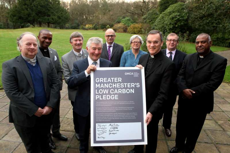 Mayor Tony Lloyd and  faith leaders from across Greater Manchester and Clive Memmott, Chief Executive of the Greater Manchester Chamber of Commerce at the ceremony