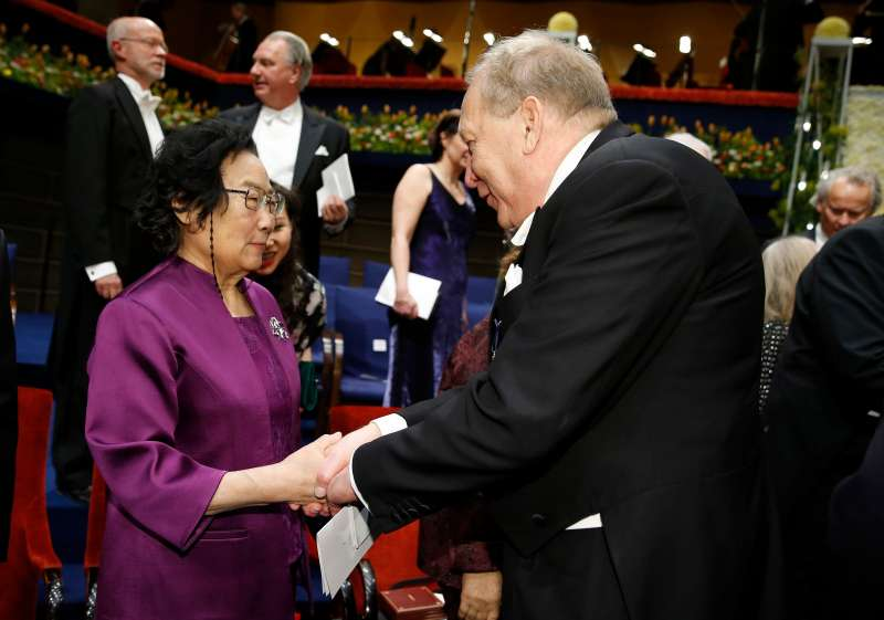 Tu Youyou, left, the 2015 Nobel laureate in Physiology or Medicine, is being congratulated following the Nobel Prize award ceremony at the Concert Hall in Stockholm, Sweden on December 10