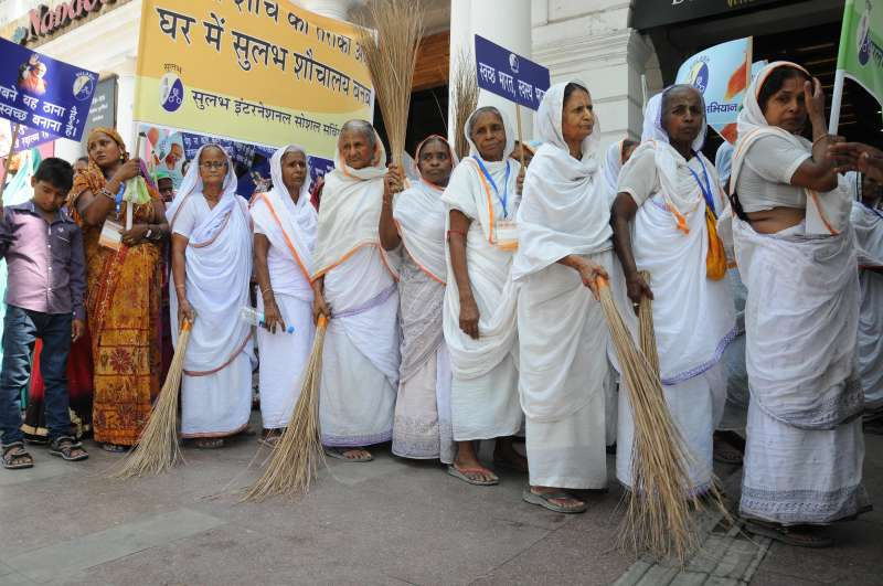Widows in Uttar Pradesh joining a cleaning campaign