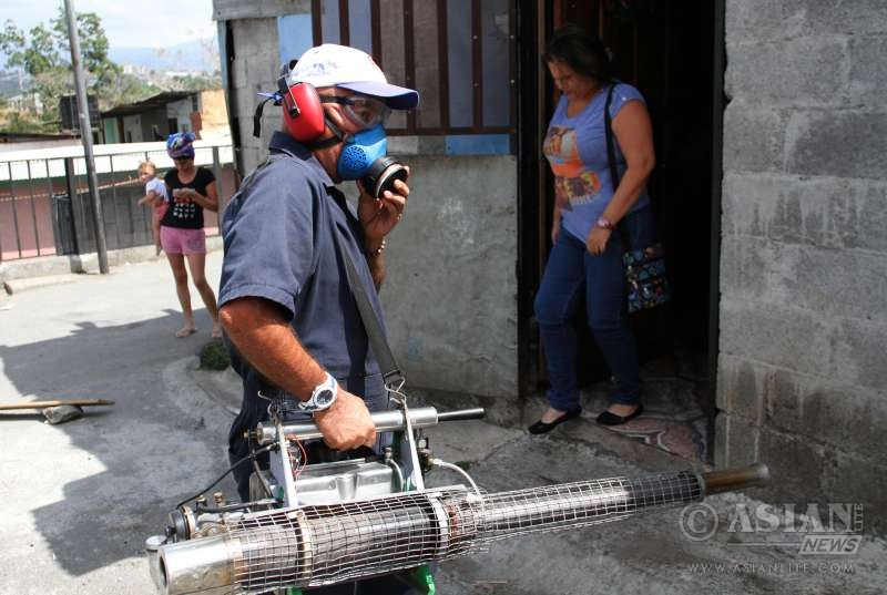 An employee of the Health Ministry takes part in a fumigation against the Aedes aegypti mosquito that can spread Zika virus at La Carpio neighborhood in San Jose, capital of Costa Rica, on Jan. 28, 2016. Costa Rican Health Ministry announced on Wednesday a series of measures to monitor the health of travelers at the air, maritime and land entry points of the country, facing the first case of Zika virus. The World Health Organization (WHO) on Thursday said it would convene an International Health Regulations emergency committee on the Zika virus to ascertain whether the outbreak constitutes a public health emergency of international concern.