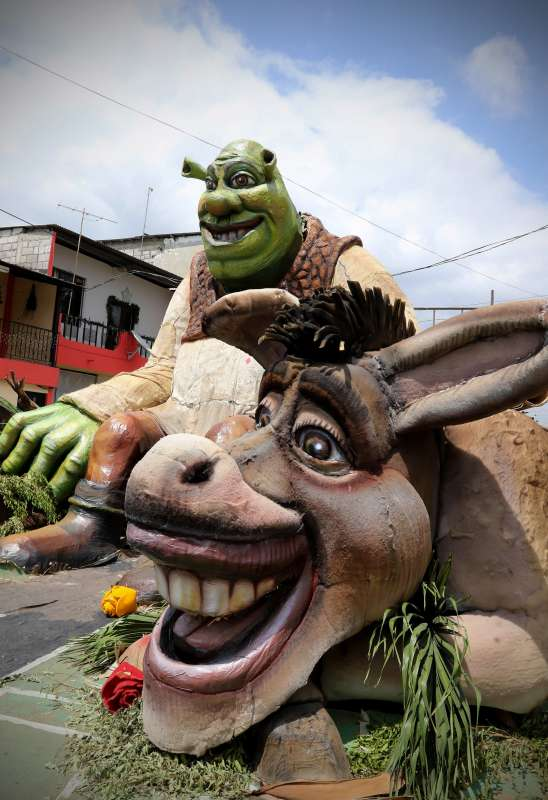 Paper and wood dolls from the stories of Shrek are displayed for sell on the street in Guayaquil, Ecuador. It is an Ecuadorian tradition to burn paper and wood dolls of cartoon characters on New Year's Eve. And in Guayaquil, the dolls are made bigger and with fine finishes