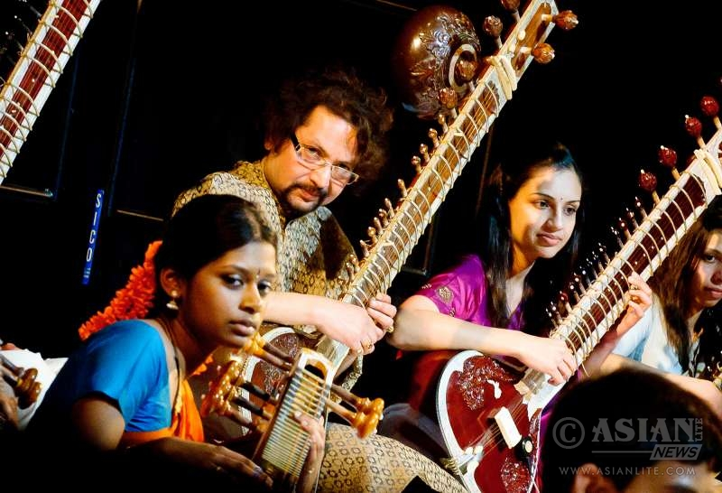 Students perform at an event at the Bhavan