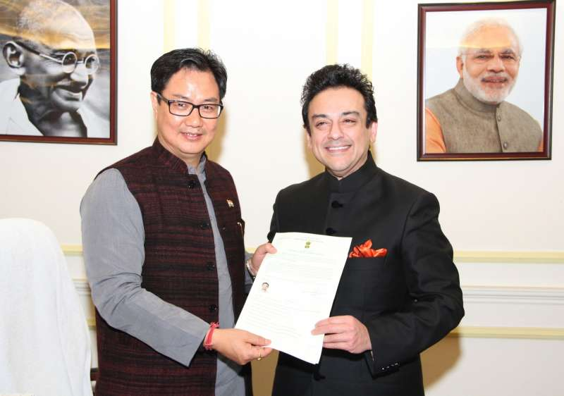 Union Minister of State for Home Affairs Kiren Rijiju presents the Certificate of Indian Citizenship by Naturalization to noted singer and musician Adnan Sami, in New Delhi
