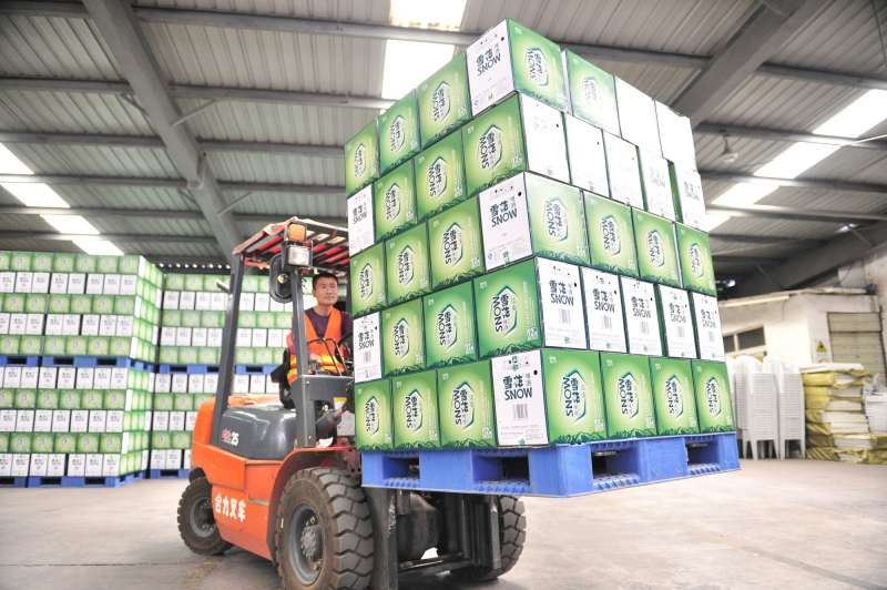 A worker transfers products at a brewery in Chengdu, capital of southwest China's Sichuan Province