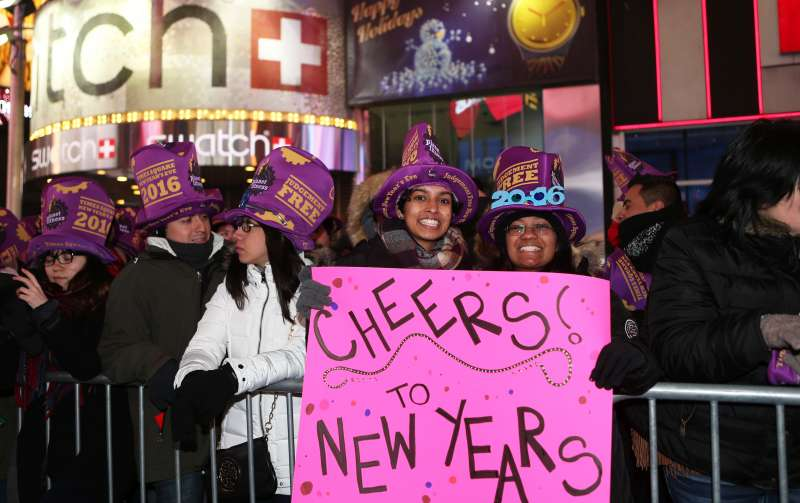 People take part in the New Year's Eve celebration at Times Square in New York, the United States