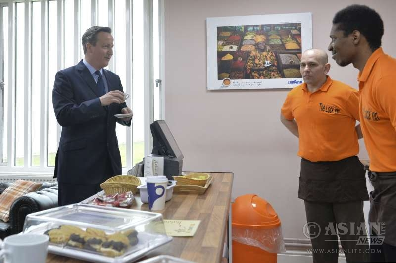 David Cameron visits HMP Onley where he observes education and work placement programmes run by Halfords and the hospitality sector.