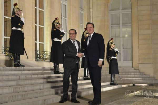 President Francois Hollande welcomes Prime Minister David Cameron to Paris for bilateral talks