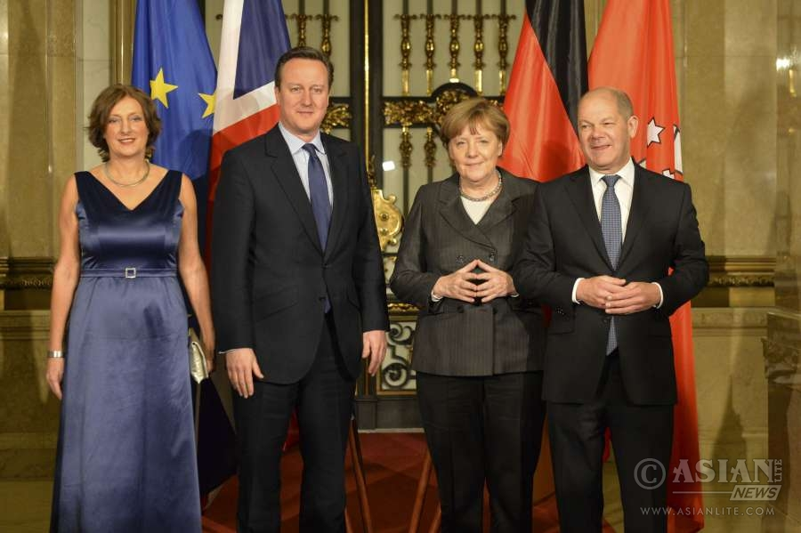 Prime Minister David Cameron arrives at the City Hall, Hamburg, where he is greeted by Chancellor Merkel and First Mayor of Hamburg, Olaf Scholz.