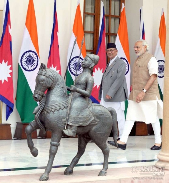 Prime Minister Narendra Modi and his Nepalese counterpart K P Sharma Oli, at Hyderabad House, in New Delhi
