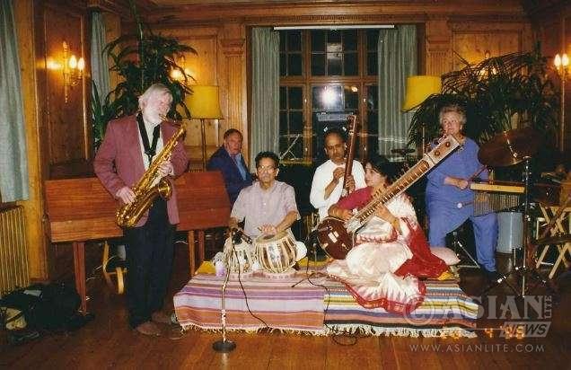 Punita paying with Jazzindo at the Burgh House, Hempstead and Punita and Madhukar Kothare