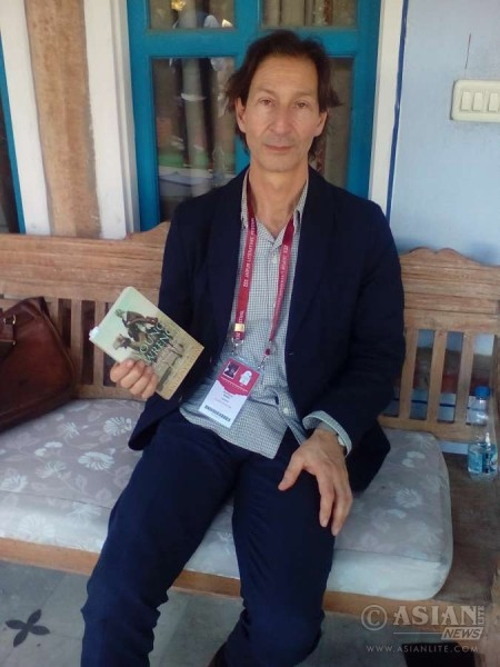 British journalist and author Anthony Sattin with his book on the young T E Lawrence