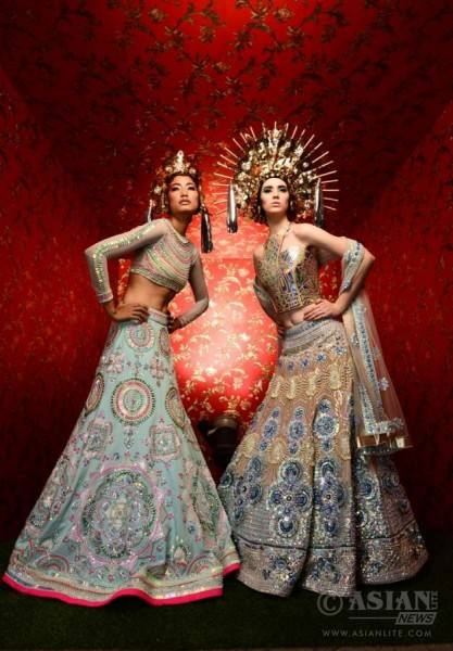 Models display Manish Arora creations