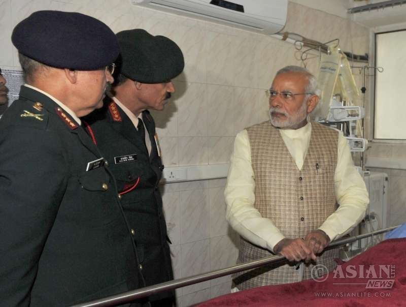 Prime Minister Narendra Modi visits Siachen survivor Lance Naik Hanumanthappa at Army`s Research & Referral Hospital, in New Delhi on Feb 9, 2016. Also seen the Chief of Army Staff, General Dalbir Singh.
