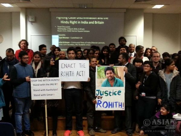 Attendees standing in solidarity with JNU students