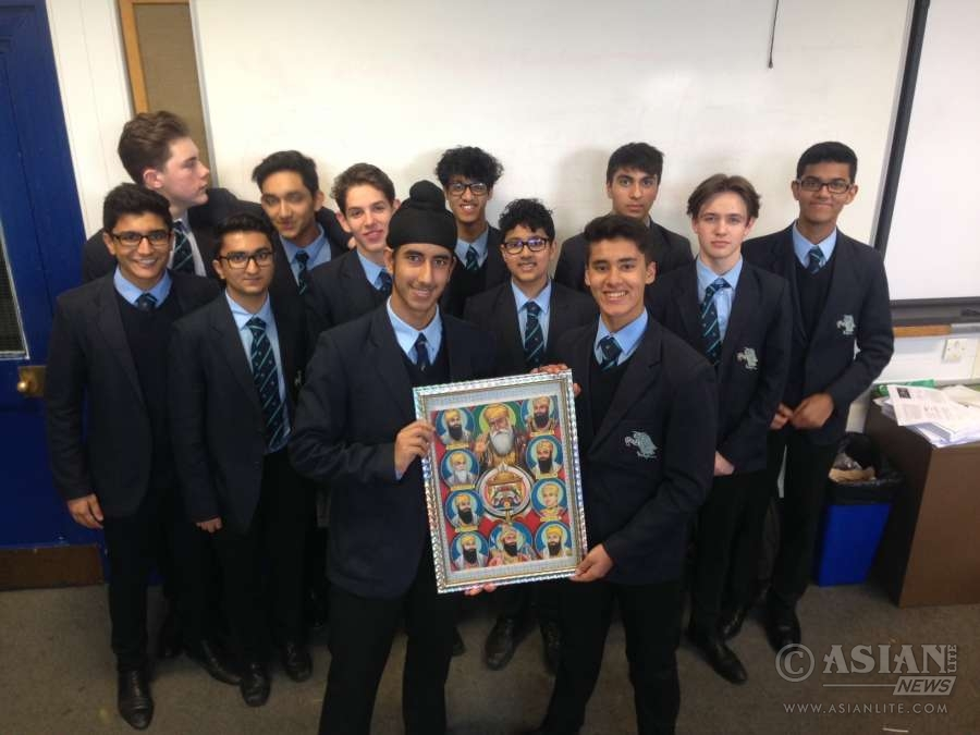 Marvy and Hukam with members of The Manchester Grammar School Sikh Society (File)