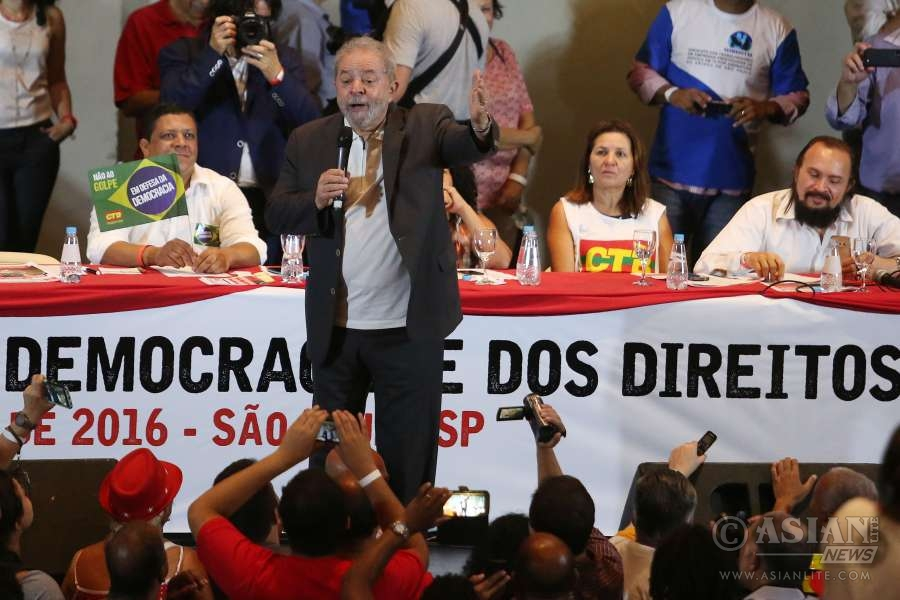 Former Brazilian President Luiz Inacio Lula da Silva talks to his supporters and members of the Workers Party in Sao Paulo, Brazil