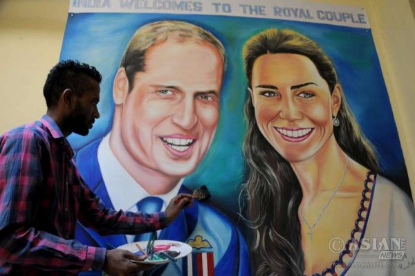 Artist Jagjot Singh Rubal givie final touches to the painting of Prince William and Kate Middleton'