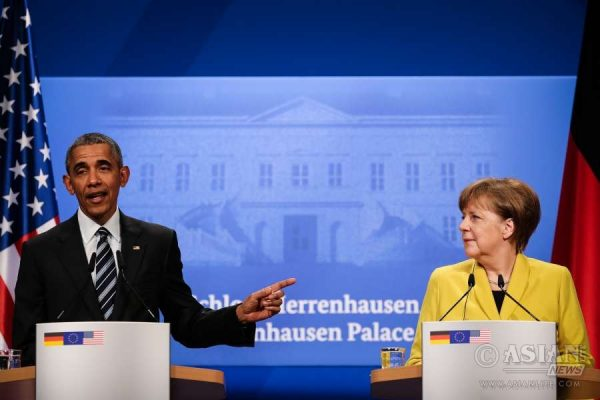 U.S. President Barack Obama (L) and German Chancellor Angela Merkel attend a press conference in Hannover, Germany, April 24, 2016. Barack Obama arrived in Hannover on April 24. He will attend the opening ceremony of Hannover industrial fair and hold talks with German Chancellor Angela Merkel