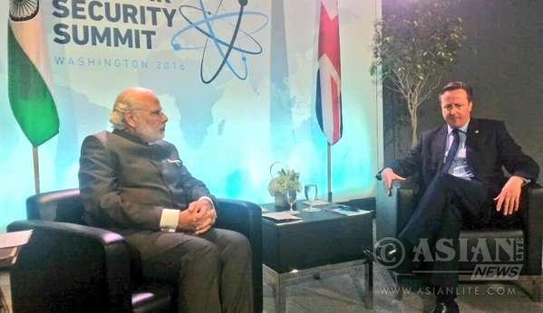 Prime Minister David Cameron with his Indian counterpart Narendra Modi