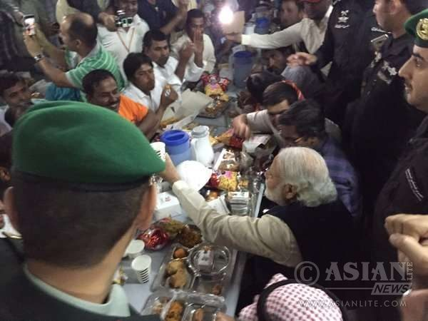 Modi eats with workers at L & T's residential complext in Riyadh