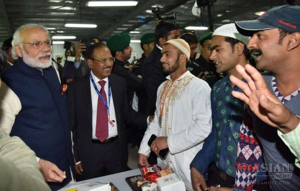 Modi interacting with the workers at the L&T residential complex, in Riyadh, Saudi Arabia