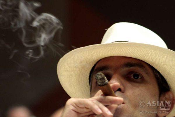 A man smokes a cigar