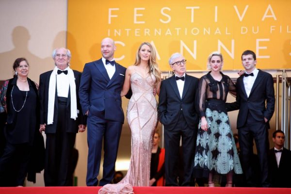 Director Woody Allen (3rd R) and cast members Blake Lively (C), Kristen Stewart (2nd R), Corey Stoll (3rd L) and Jesse Eisenberg (1st R) of the opening film Cafe society pose on the red carpet before the opening of the 69th Cannes Film Festival in Cannes, France, on May 11, 2016. The 69th Cannes Film Festival will be held from May 11 to 22.