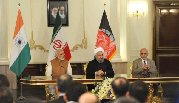 Prime Minister Narendra Modi, President of Iran Hassan Rouhani and the President of Afghanistan, Dr. Mohammad Ashraf Ghani, witness the signing of trilateral agreements between India, Afghanistan and Iran, in Tehran, Iran