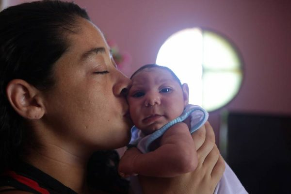 Pollyana Rabello  holding her baby, Luiz Philipe, who was born with microcephaly, in their house in Marica, Rio de Janeiro state. Brazil has confirmed 1,581 cases of microcephaly related to the Zika virus since October last year (File)
