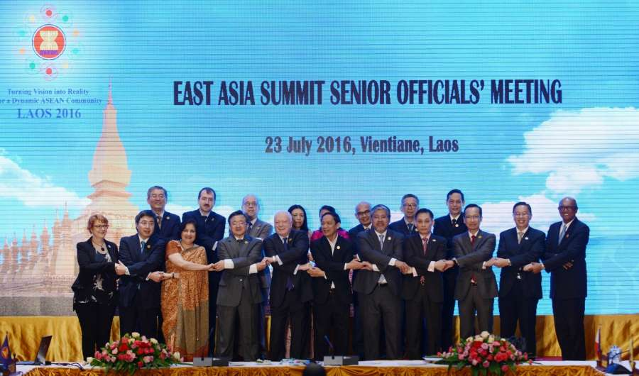 Officials pose for group photos before the East Asia Summit Senior Officials' Meeting in Vientiane, capital of Laos