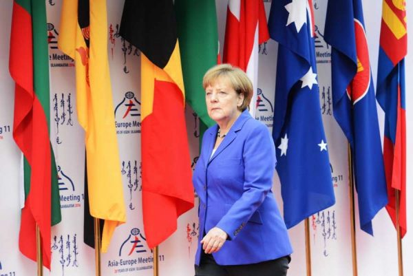 """German Chancellor Angela Merkel arrives for the 11th Asia-Europe Meeting (ASEM) Summit in Ulan Bator, capital of Mongolia, on July 15, 2016. The 11th Asia-Europe Meeting (ASEM) Summit opened in Ulan Bator, capital of Mongolia, on Friday to promote """"partnership for the future through connectivity."""""""