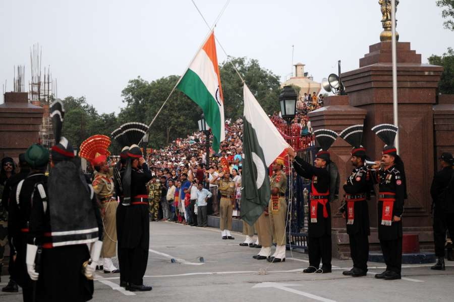 Pakistani Rangers (black uniform) and Indian Border Security Force (BSF) personnel perform the flag off ceremony at the Pakistan-India Wagah Border near eastern Pakistan's Lahore