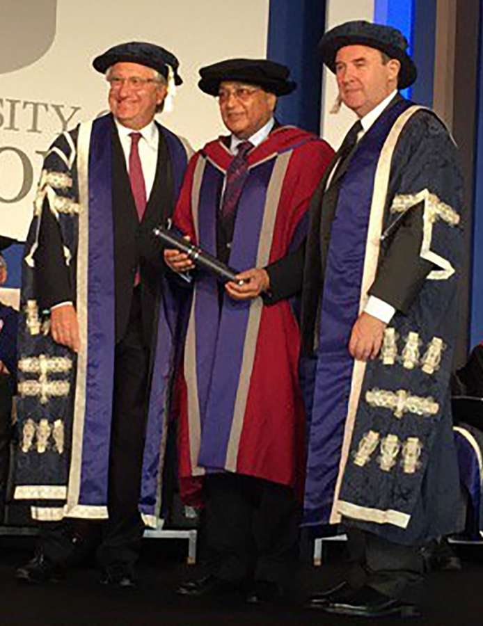 Dr Rami Ranger CBE, Chairman of Sun Mark Ltd and Sea, Air and Land Forwarding awarded Honorary Doctor of Letters (Hon DLitt) by Mr Laurence Geller CBE & Professor Peter John, Vice-Chancellor of the University of West London