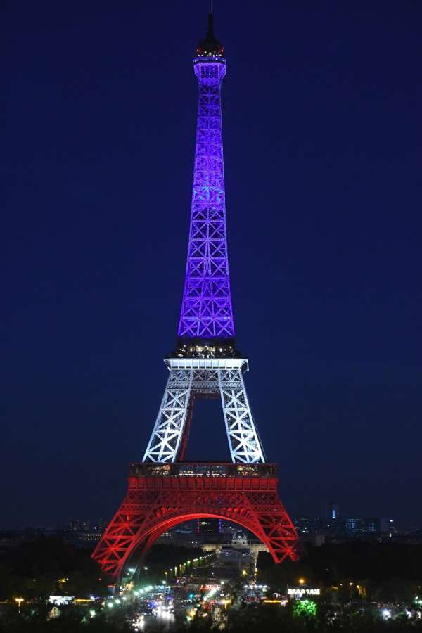The Eiffel Tower is illuminated in the colors of the French national flag to pay tribute to the victims of the Nice terrorist attack, in Paris