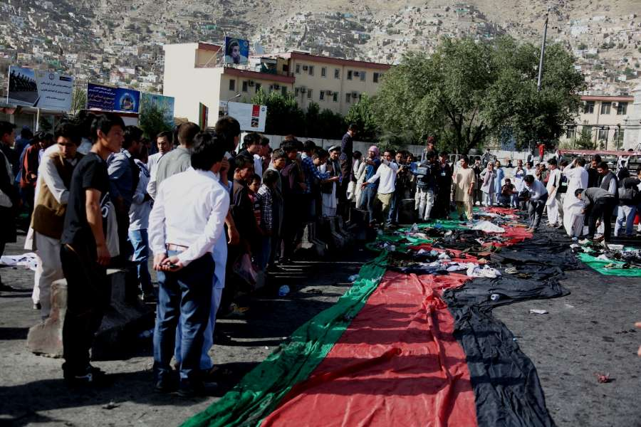 People gather at the site of a blast in Kabul, capital of Afghanistan, July 23, 2016. At least 61 people were killed and some 207 others wounded after a deadly blast hit a peaceful protest in Afghan capital of Kabul on Saturday