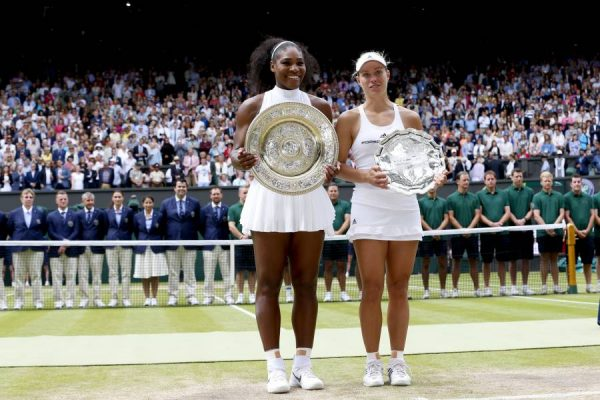 Serena Williams (L) of the United States and Angelique Kerber of Germany pose with their trophies after the women's singles final on Day 12 at The Championships Wimbledon 2016 in London, Britain on July 9, 2016. Serena Williams won 2-0