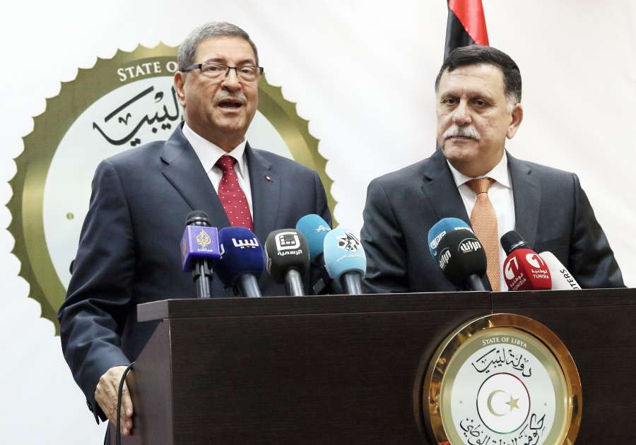 Tunisian Prime Minister Habib Essid (L) speaks during a press conference with Fayez Sarraj, prime minister of the UN-backed Libyan unity government, in Tripoli, capital of Libya