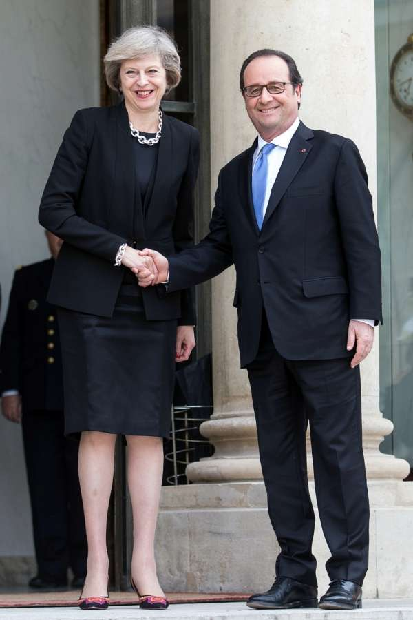 French President Francois Hollande(R) shakes hands with British Prime Minister Theresa May during their meeting at the Elysee Palace in Paris, France on July 21, 2016. French President Francois Hollande on Thursday called on Britain to prepare for talks to leave the European Union(EU) as soon as possible