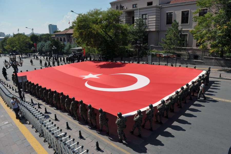 Turkish soldiers with national flag participate in the military parade marking the 94th anniversary of the Victory Day in the mausoleum of Mustafa Kemal Ataturk, the leader of the Turkish War of Independence and the founder and first President of the Republic of Turkey in Ankara, capital of Turkey