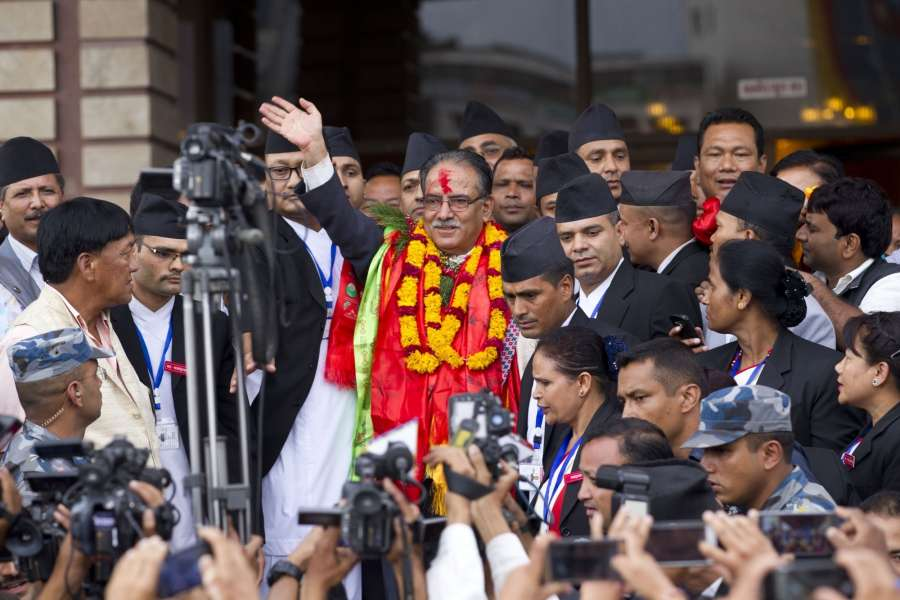 Nepal's newly elected Prime Minister Puspa Kamal Dahal (C) waves  at supporters